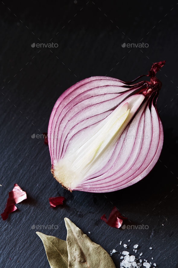 Sliced red spanish onion with bay leaf and sea salt - Stock Photo - Images
