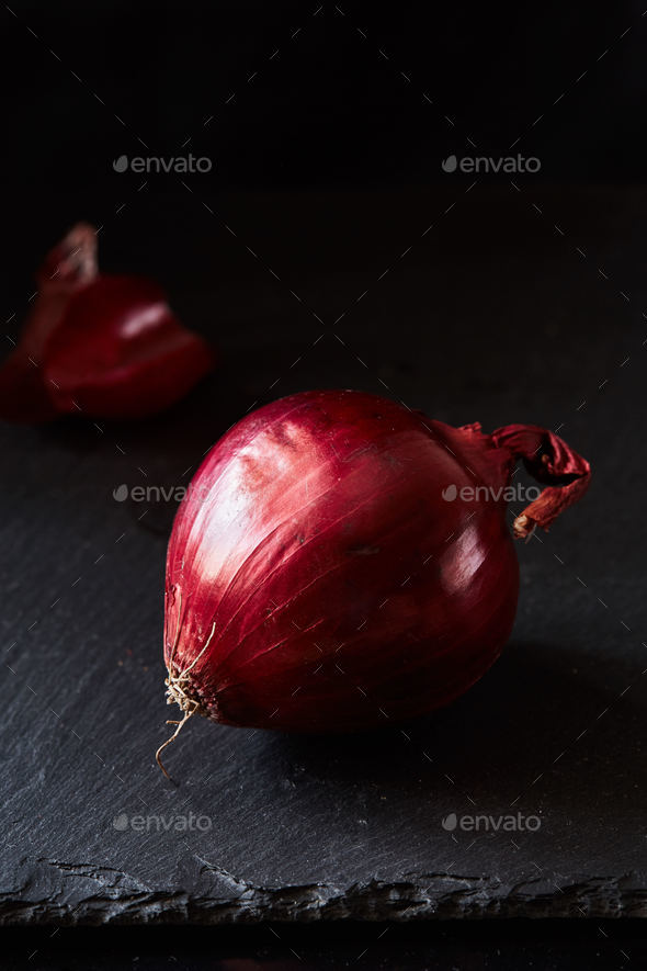 Red spanish onion with peel - Stock Photo - Images