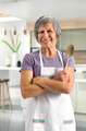 Happy friendly senior woman baking in the kitchen - PhotoDune Item for Sale