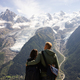 couples watching the stunning view of Mont Blanc - PhotoDune Item for Sale
