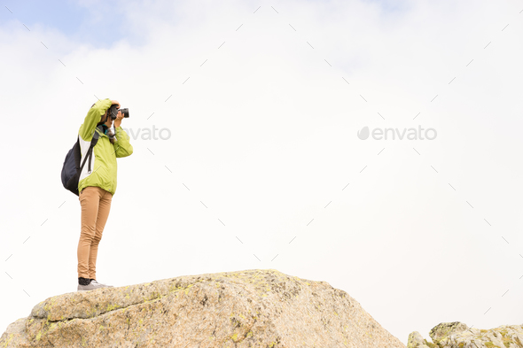 Photographer on a rock - Stock Photo - Images