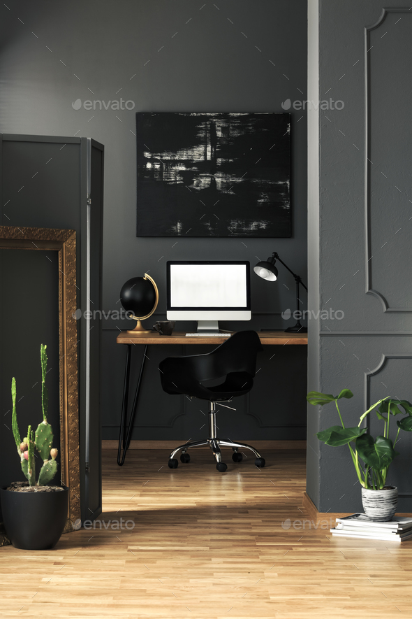 Dark living room interior with molding on walls in real photo wi - Stock Photo - Images