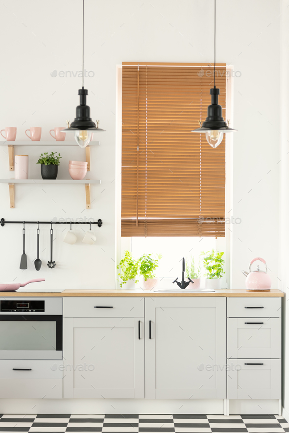 Real photo of a modern kitchen interior with wooden window blind - Stock Photo - Images