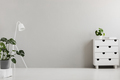 Empty gray bedroom interior with a modern dresser, an industrial - PhotoDune Item for Sale