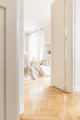 View through tall, open white door on a stylish, bright bedroom - PhotoDune Item for Sale