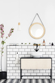 Round mirror on white wall above washbasin in modern bathroom in - PhotoDune Item for Sale