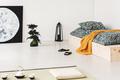Orange blanket on wooden bed in bedroom interior with moon poste - PhotoDune Item for Sale