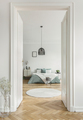 Real photo of open door to bright bedroom interior with king-siz - PhotoDune Item for Sale