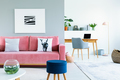 Painting above pink sofa with pillows in open space interior wit - PhotoDune Item for Sale