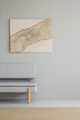 Real photo of a minimal living room interior with a burlap artwo - PhotoDune Item for Sale