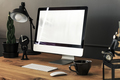 Keyboard, mouse and desktop computer on wooden desk with lamp in - PhotoDune Item for Sale