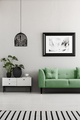 Poster above green couch next to cupboard with plants in living - PhotoDune Item for Sale