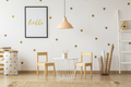 Pastel lamp above table and wooden chairs in gold child's room i - PhotoDune Item for Sale