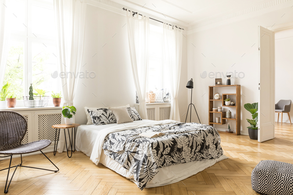 An interior of a bedroom with herringbone parquet, white walls a - Stock Photo - Images