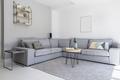 Grey corner sofa and wooden table in spacious living room interi - PhotoDune Item for Sale