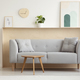 Wooden table in front of grey sofa in simple living room interio - PhotoDune Item for Sale