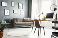 Real photo of a bright home office interior with a sofa, graphic - PhotoDune Item for Sale