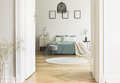 Real photo of white bedroom interior with round rug, king-size b - PhotoDune Item for Sale
