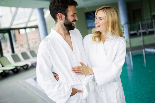 Portrait of attractive couple in spa center - Stock Photo - Images