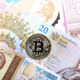 Bitcoin coin on the background of Polish banknotes  - PhotoDune Item for Sale