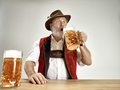 Germany, Bavaria, Upper Bavaria, man with beer dressed in traditional Austrian or Bavarian costume - PhotoDune Item for Sale