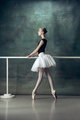 The classic ballerina posing at ballet barre - PhotoDune Item for Sale