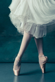 Close-up ballerinas legs in pointes on the gray wooden floor - PhotoDune Item for Sale