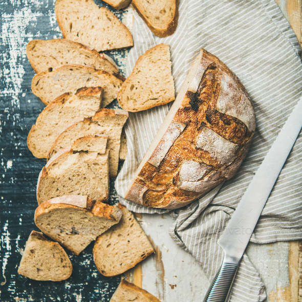Sourdough wheat bread loaf cut in slices, square crop - Stock Photo - Images