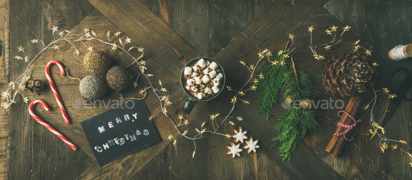 Flat-lay of greeting card, glittering toys, mug of hot chocolate, - Stock Photo - Images