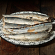 plate of marinated sardines, on rustic wood - PhotoDune Item for Sale