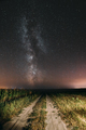Night Starry Sky With Milky Way Glowing Stars Above Country Road - PhotoDune Item for Sale