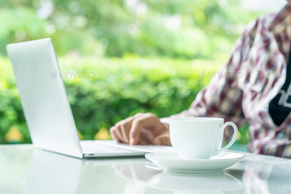 Laptop computer and cup of coffee on the table _ - Stock Photo - Images