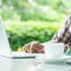 Laptop computer and cup of coffee on the table _ - PhotoDune Item for Sale