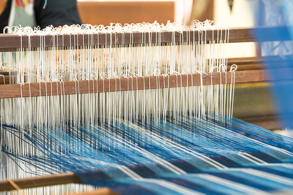 Weave silk cotton on the manual wood loom - Stock Photo - Images
