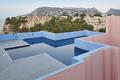 Geometric building swimming pool. Red wall, La manzanera. Calpe, Spain - PhotoDune Item for Sale