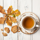 Autumn background with oak leaves, cup of tea and oat cookies - PhotoDune Item for Sale