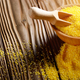 Scoop in Bowl of corn grits on kitchen table - PhotoDune Item for Sale