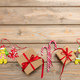 Candy canes, christmas ornaments and a gift box with red ribbon on wooden background, copy space - PhotoDune Item for Sale