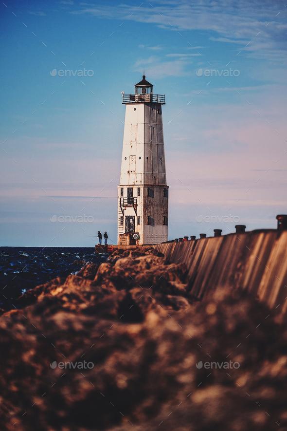 Fishermen and lighthouse - Stock Photo - Images