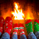 Family in Christmas socks near fireplace - PhotoDune Item for Sale