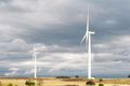 Wind turbines against dark clouds - PhotoDune Item for Sale