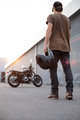 biker guy in front of classic style motorcycle - PhotoDune Item for Sale