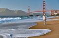 Woman walking on beach near Golden Gate Bridge - PhotoDune Item for Sale