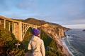 Woman tourist near Bixby Creek Bridge in California - PhotoDune Item for Sale