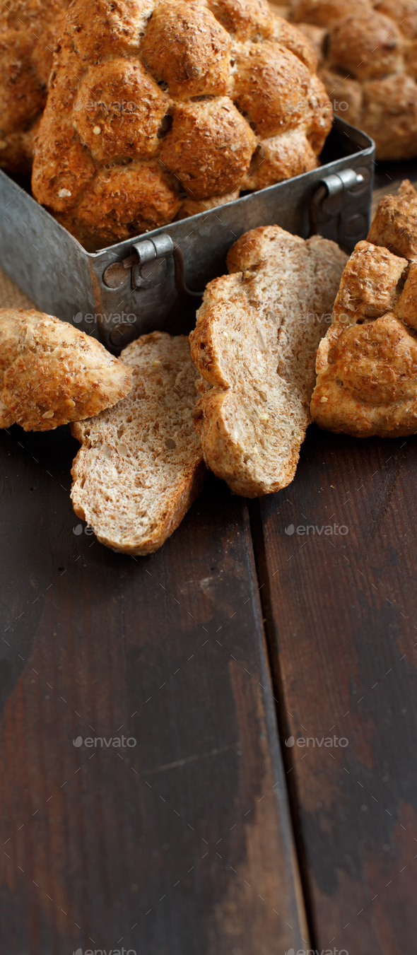 Whole wheat bread on a Wooden Table - Stock Photo - Images