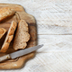 Whole wheat bread on a Wooden Table - PhotoDune Item for Sale