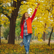 Girl with long wavy hair enjoying autumn in the park. - PhotoDune Item for Sale