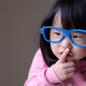 Funny little child with big blue glasses - PhotoDune Item for Sale