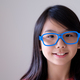 Portrait of Asian teenager with big blue glasses - PhotoDune Item for Sale