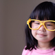 Funny little child with big yellow glasses - PhotoDune Item for Sale